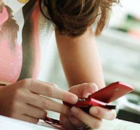 Texting teen (iStock)