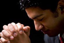Man praying (iStock)