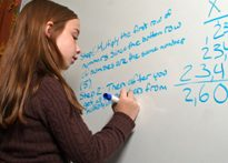 Math at the board (John Archer, iStock)