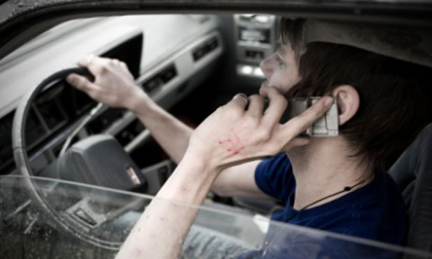 Driver talking on a cell phone (iStock)
