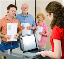 Young woman with optical-scan voting machine (iStock)