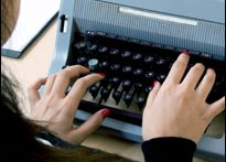 Woman at typewriter (iStock)