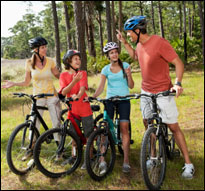 Family bicycling (iStock)