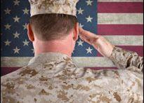 U.S. soldier saluting flag (iStock)