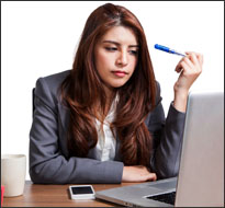 Young worker at computer (iStock)