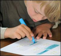 Student highlighting work (iStock)