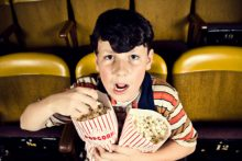 Kid at the movies (iStock)