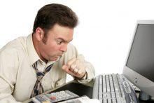 Sick man at work (iStock)