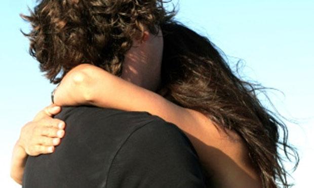 Couple embracing (iStock)