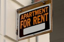 For-rent sign on building (iStock)