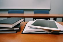 Books and tablet on a classroom desk