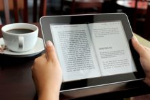 Reading iPad at breakfast (iStock)