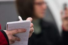 reporter and notepad (iStock)
