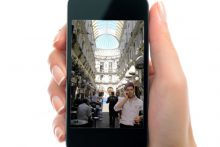 Hand holding iPhone (iStock)