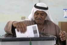 Iraqi votes on new constitution (U.S. Navy)