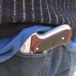 teen with toy gun (iStock)