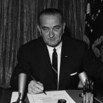 President Lyndon B. Johnson signs Tonkin resolution, 1964 (NARA)