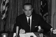 President Lyndon B. Johnson signs Tonkin resolution, 1964 (NARA)