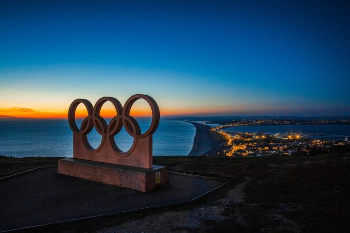 Olympic rings monument at night