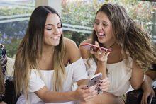 Two women using smartphones
