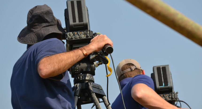 Two people with video cameras