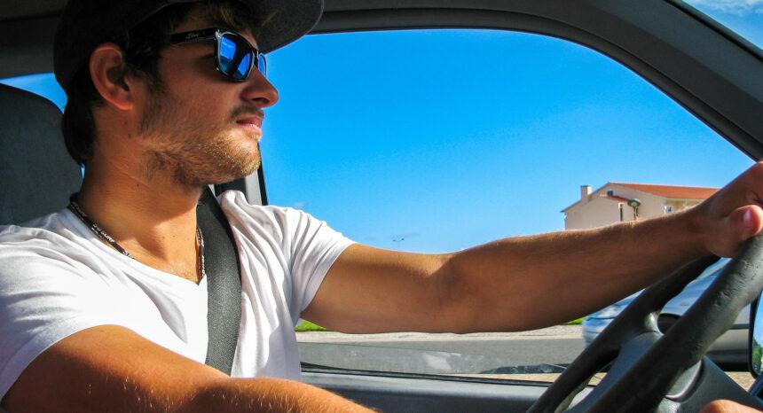 Man driving wearing seat belt