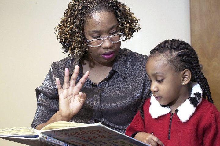 Black teacher with black student