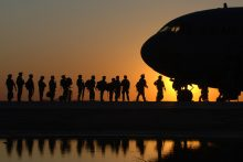 Soldiers boarding a plane