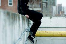 teenager on wall