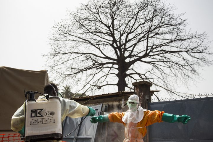 Ebola burial team disinfecting