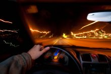Person driving car at night
