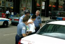 Man being arrested by police
