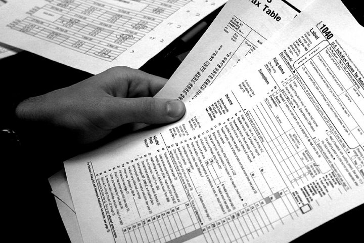 Person holding federal tax return forms