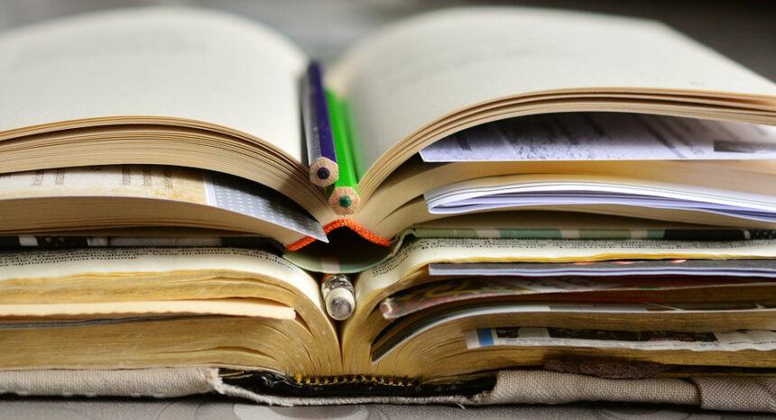 Stacks of open books