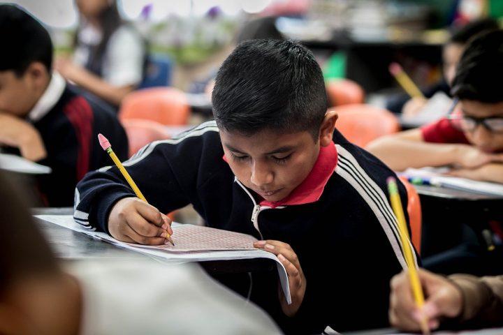 Boy in class taking a test