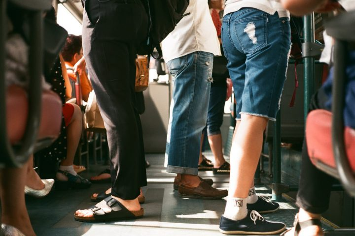 People riding on the subway.