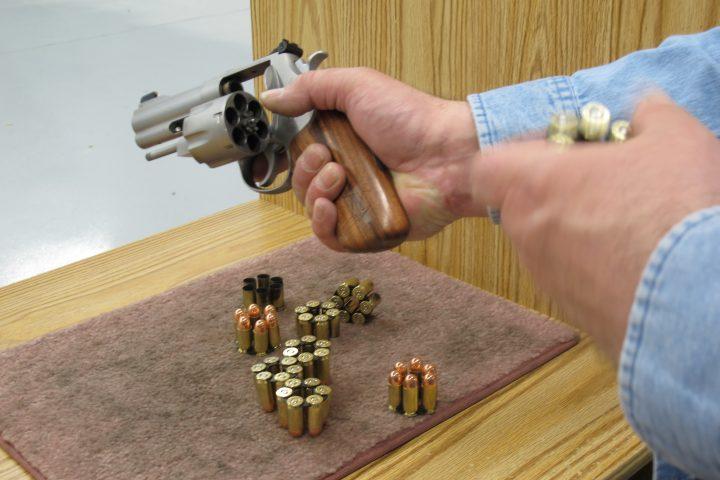 Man examining revolver