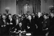 President Lyndon B. Johnson signs the 1964 Civil Rights Act