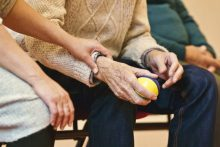 elderly person holding ball