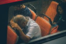man on bus in rain