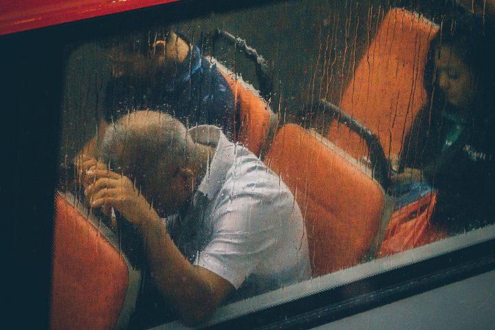 man on bus in rain