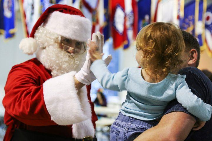 Santa interacting with small child