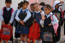 Children wearing school uniforms
