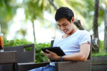 Young man using tablet.