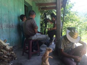 Journalists Daffodil Altan and Andrés Cediel interview a family at a home in Guatemala.
