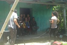 Journalists Daffodil Altan and Andrés Cediel prepare to interview a family in Guatemala.