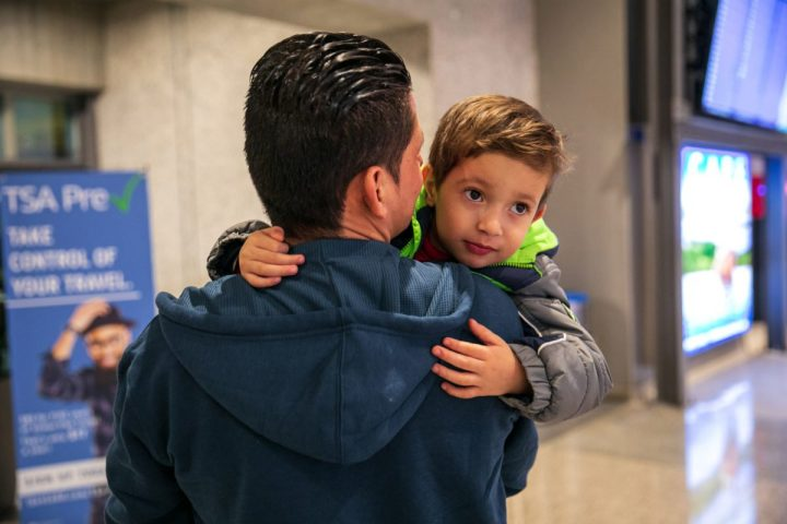 Julio holds his son Brayan, 4, at Austin-Bergstrom International Airport in Austin. (Ilana Panich-Linsman for ProPublica)