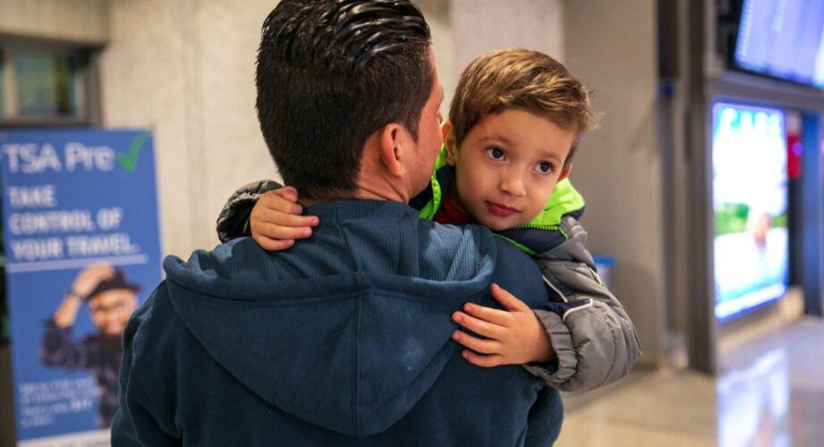 Julio holds his son Brayan, 4, at Austin-Bergstrom International Airport in Austin. (Ilana Panich-Linsman for ProPublica)