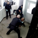 Screenshot of video showing police hitting handcuffed man
