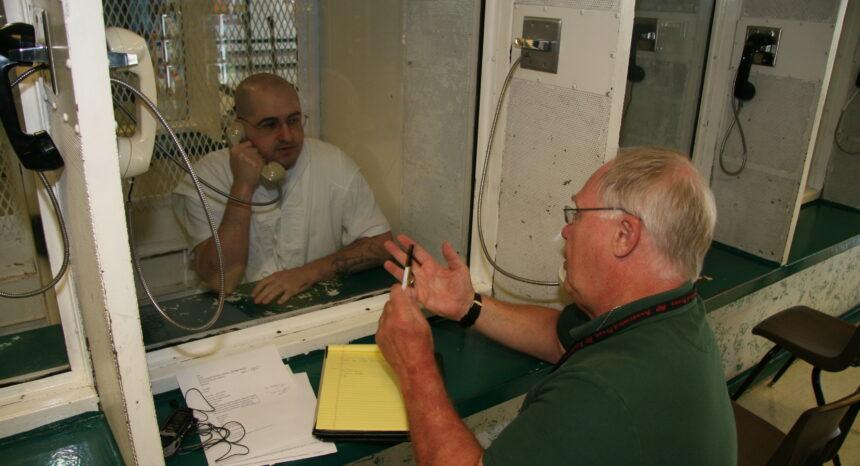 Associated Press reporter Michael Graczyk interviews death row inmate Juan Castillo in Texas. (Courtesy of Michael Graczyk)